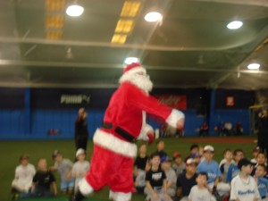 Santa throws out the 1st pitch of the holiday season
